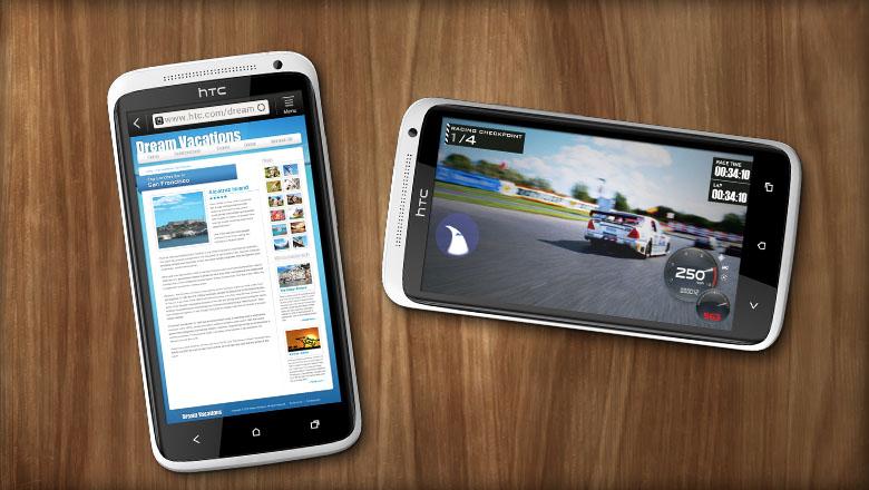 Zwei weisse HTC One XL, eines mit offenem Browser das andere mit einem Game